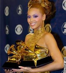 Beyonc� in  with her five Grammys.