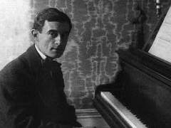 Maurice Ravel by the piano