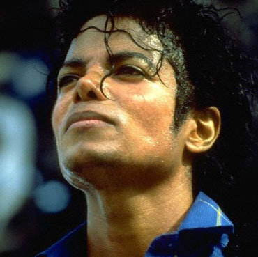 Michael Jackson in  , after several cosmetic surgeries. In this picture, his skin is fairly dark, although photographs taken earlier in the year show it significantly whiter (most notably, the Bad album cover). Photographs from this era show noticeably different skin tones, suggesting that heavy makeuping was used to achieve Jackson's skin tone and  facial features during this period.